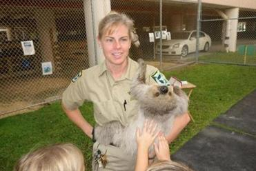 Supervisor Jeanne Selander with a sloth at the children's zoo at the county detention center.